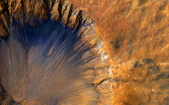 A Fresh Crater Near Sirenum Fossae