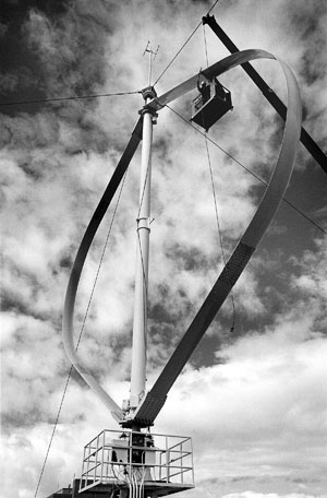 A Sandia team completes installation in the late 1980s of a vertical axis wind turbine test platform in Bushland, Texas