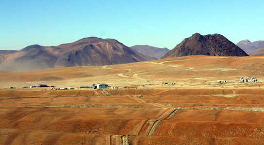 Chile's Chajnantor plateau, some 5 kilometers above sea level, is the home of a new supercomputer specially designed to run the ALMA radio telescope array (dishes at lower right). Credit: ALMA (ESO/NAOJ/NRAO), Carlos Padilla