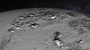 Animated New Horizons Flyover of Pluto's Icy Mountain and Plains