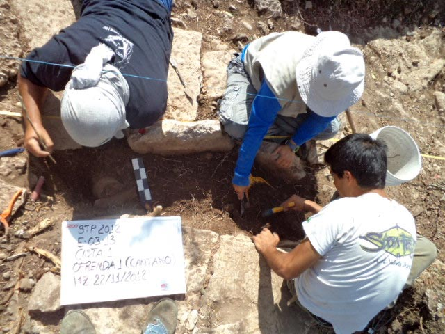 Archaeologists Excavating Cist Burial