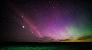 Astronomers Solve Mystery of Purple Lights in Sky