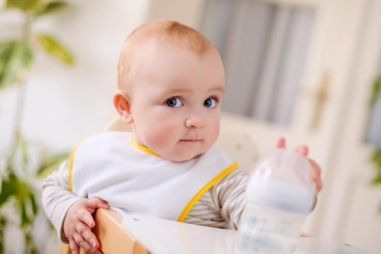 Baby With Plastic Bottle