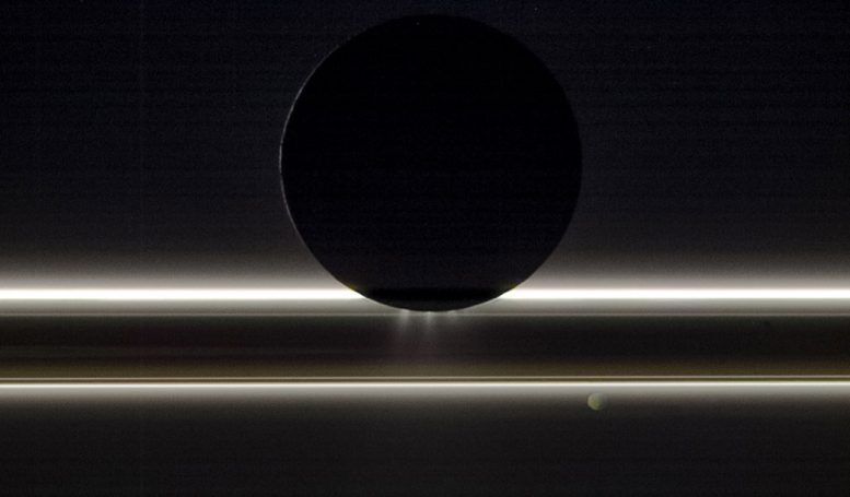 Cassini Image of Enceladus Drifting By Saturn's Rings