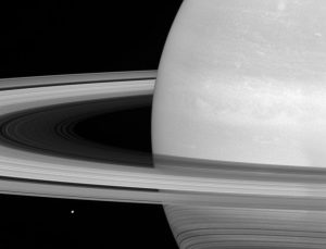 Cassini Sees Tiny Mimas Huge Rings