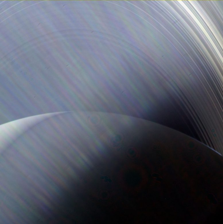 Cassini Spacecraft Sees Saturn and Its Rings Through a Haze of Sun Glare