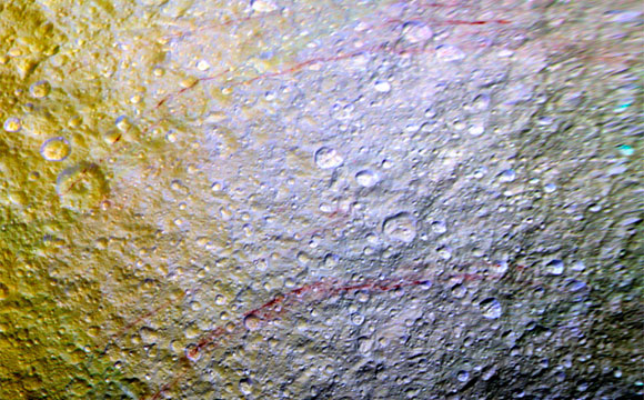 Cassini Spots Unusual Red Arcs on Icy Saturn Moon