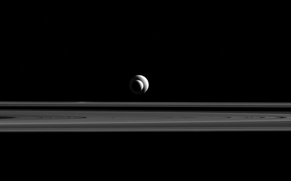 Cassini Views Enceladus and Tethys and Saturn's Rings