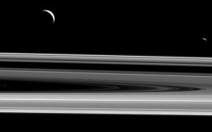 Cassini Views Moons Enceladus and Janus