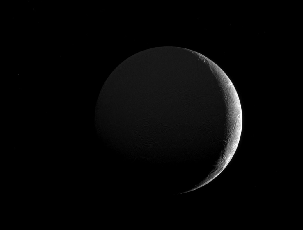 Cassini Views the Slim Crescent of Saturn's Moon Enceladus