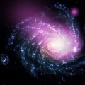Chandra Spots Dwarf Galaxy Colliding with NGC 1232
