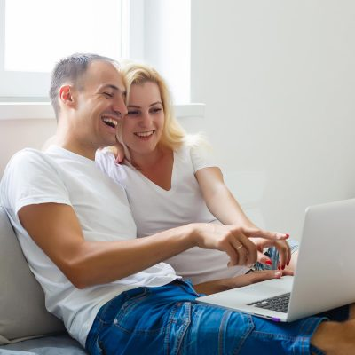 Couple Laughing Computer