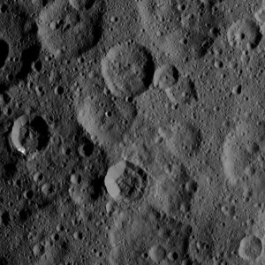 Dawn Spacecraft Views Craters Takel and Cozobi