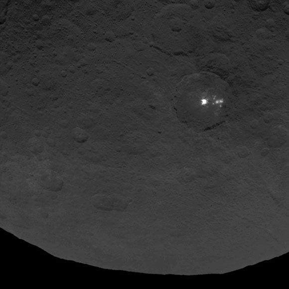 A cluster of mysterious bright spots on dwarf planet Ceres can be seen in this image, taken by NASA's Dawn spacecraft from an altitude of 2,700 miles (4,400 kilometers). The image was taken on June 9, 2015.
