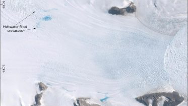 Antarctic Glaciers Slipping Faster Towards the Ocean Due to Surface Melting