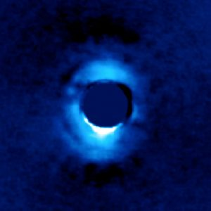 Dusty Disk of Planetary Material Surrounding Young Star HD 141569