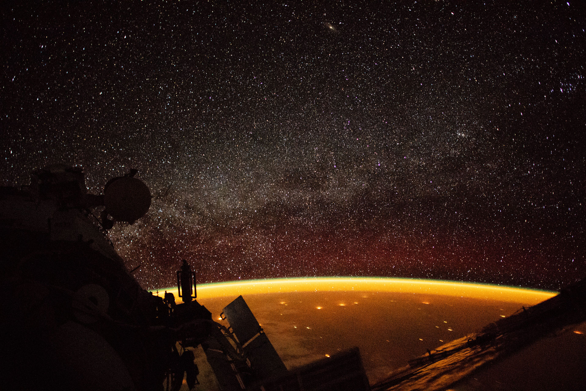 international space station view of earth enveloped in airglow