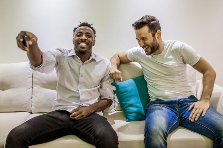 Guys Laughing Couch