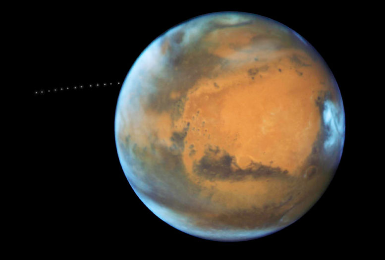 Hubble Sees Moon Orbiting Mars