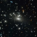 Hubble Views Galaxy Cluster Abell S1077