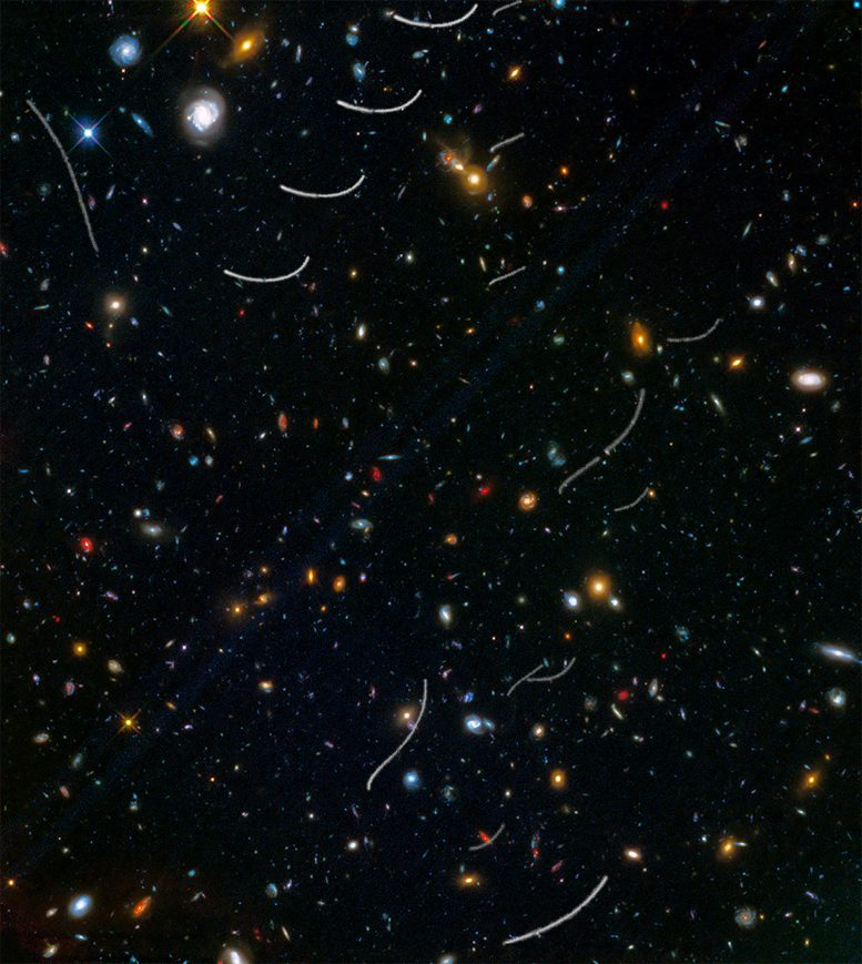 Hubble Views Nearby Asteroids Photobombing Distant Galaxies