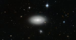 Hubble Views Spiral Galaxy MCG+01-02-015