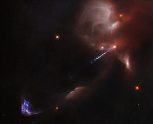 Hubble Views the Outburst of an Extremely Young Star