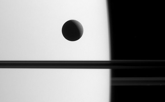 Image of Saturn's Moon Dione Crossing the Face of Saturn