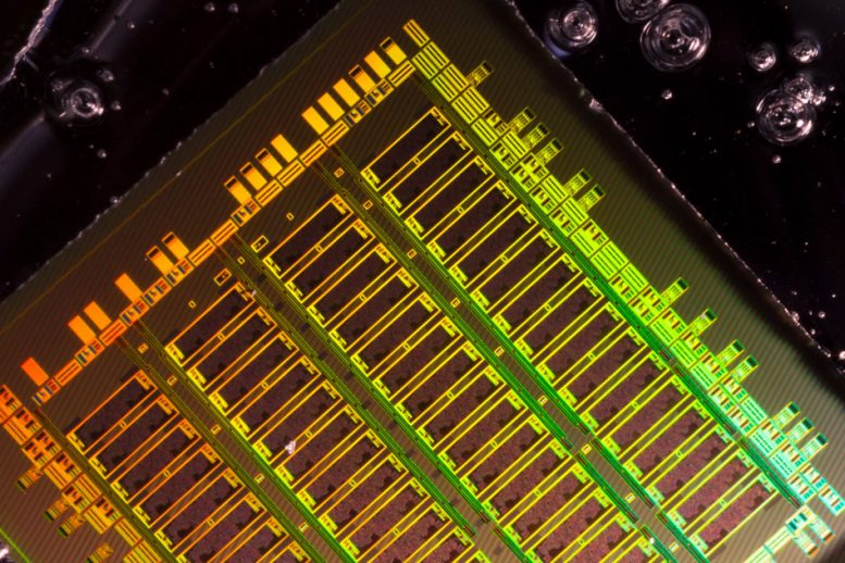 Integrating Photonics with Silicon Nanoelectronics