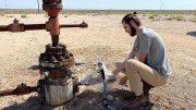 Jacob Hoschouer Samples Inactive Oil Well