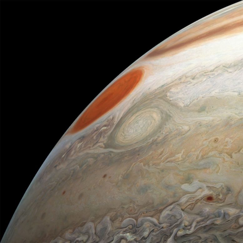 Juno's latest flight shows two massive storms