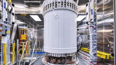 Dark Matter Experiment's Time Projection Chamber Transported Nearly a Mile Underground