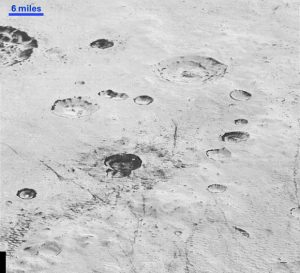 Layered Craters and Icy Plains of Pluto