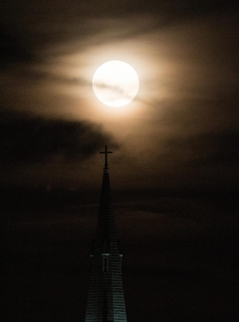 Moon rising behind the steeple of St. Dominic's Church