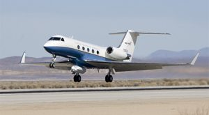 NASA's Gulfstream-III research testbed with the UAV synthetic aperture radar pod under its belly lifts off from the Edwards Air Force Base runway.