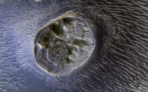 NASA's Mars Reconnaissance Orbiter Views a Small Mesa in Noctis Labyrinthus