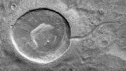 NASA's Mars Reconnaissance Orbiter Views a Tadpole Shaped Impact Crater