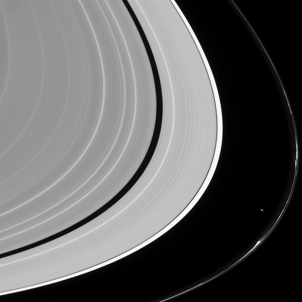 Cassini Image of Saturn's Rings and Its Moon Prometheus