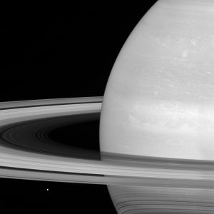 New Cassini Image of Tiny Mimas Huge Rings