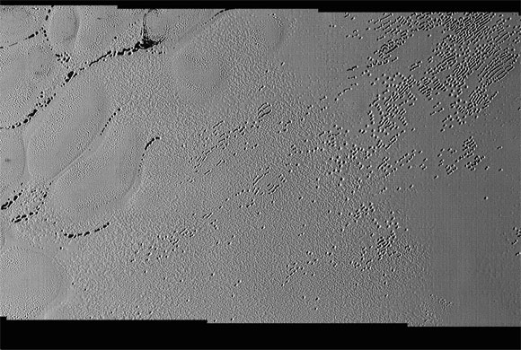 New Horizons Images Reveal Puzzling Patterns and Pits on Pluto