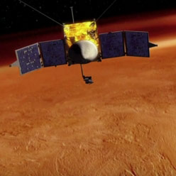 ScienceCast Video Examines the Possibility of Colliding Atmospheres between Mars and Comet Siding Spring