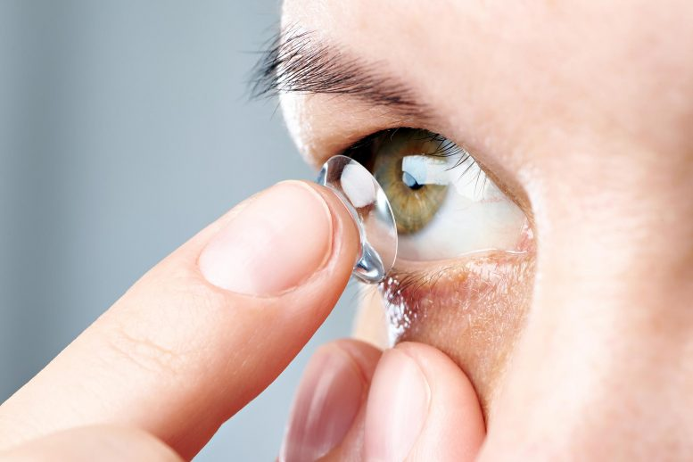 Putting On Contact Lens