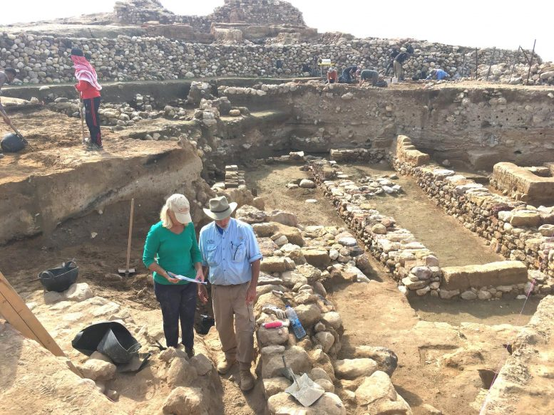 Researchers Stand Near the Ruins of Ancient Walls