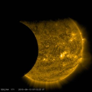 SDO Views Earth and the Moon Transiting the Sun