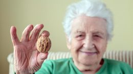 Senior Woman Holding Walnut