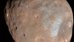 Solar Eruptions Could Electrify Martian Moons