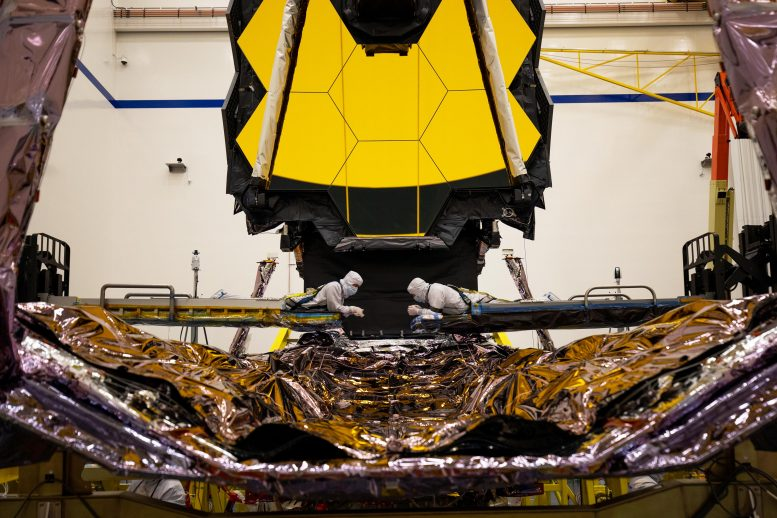 Technicians Inspect James Webb Space Telescope's Deployable Tower Assembly