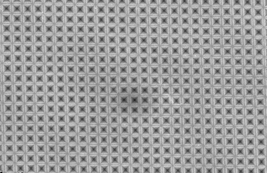 Textured surface may boost power output of silicon solar cells