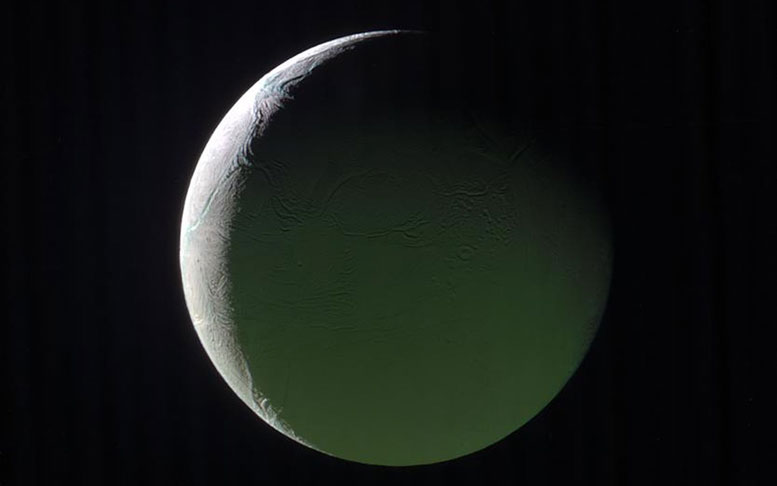 The Brightly Lit Limb of a Crescent Enceladus