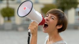 Woman Yelling Into Megaphone